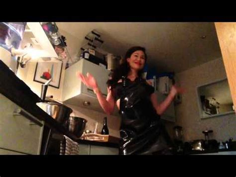 Helga In Brown Rubber Apron - AgaClip - Make Your Video Clips